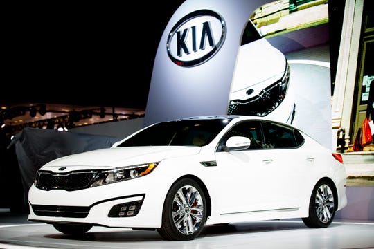FILE- In this March 27, 2013, file photo the 2014 Kia Optima is unveiled during the 2013 New York International Auto Show in New York. The probes cover the 2011 through 2014 Hyundai Sonata and Santa Fe, the 2011 through 2014 Kia Optima and Sorento, and the 2010 through 2015 Kia Soul.