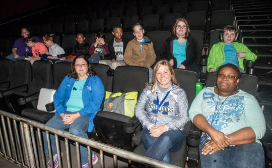 """Conswello Chambliss, right, a resource teacher at Marbury Middle School and her students attended a sensory-friendly version of the animated film """"Wonder Park"""" on Tuesday, April 2, 2019, at New Vision Theatre at Promenade 12 in Prattville, Ala."""