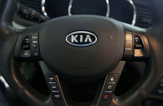 This Oct. 5, 2012, file photo, shows a Kia optima's steering wheel inside of a Kia car dealership in Elmhurst, Ill. The U.S. government's highway safety agency said 'it has decided to open two new investigations into fires involving Hyundai and Kia vehicles.'