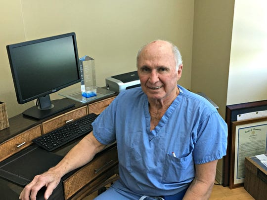 Dr. O. Tom Johns sits in his office at Saint Thomas Rutherford Hospital.