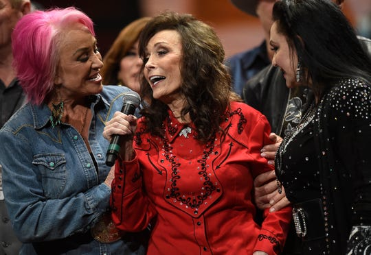 "Tanya Tucker(lt) and Crystal Gayle (rt) join Loretta Lynn singing ""Coal Miner's Daughter"" to end the Loretta Lynn: An All-Star Birthday Celebration Concert at Bridgestone Arena Monday, April 1, 2019 in Nashville, Tenn."