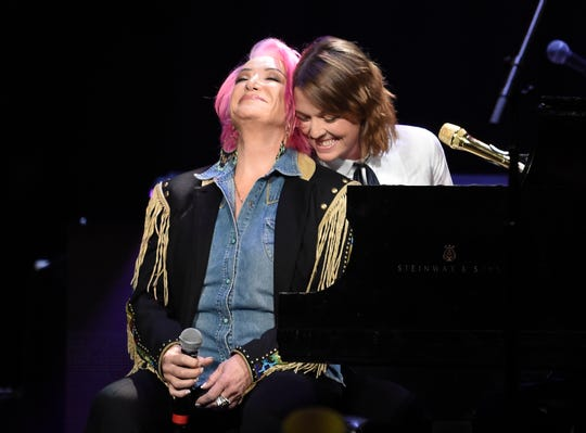 Tanya Tucker and Brandi Carlile perform during the Loretta Lynn birthday celebration concert at Bridgestone Arena on April 1 in Nashville.