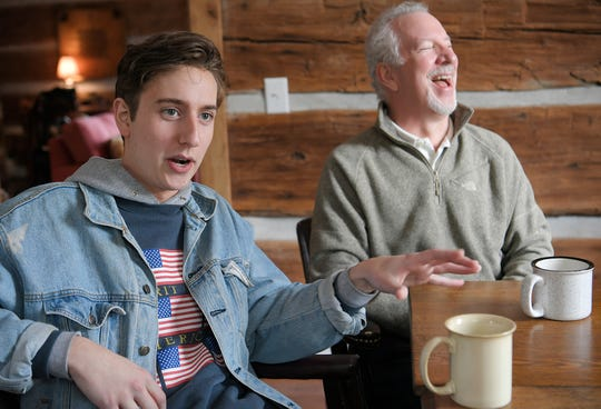 Campbell Valentine, left, cracks up his dad, conservative radio personality Phil Valentine, while talking about their new podcast that has nothing to do with politics.