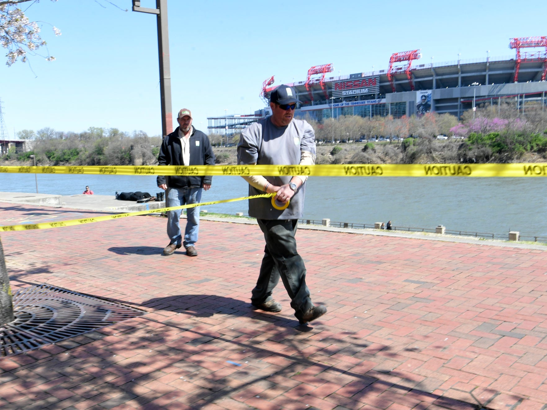 Metro Parks and Recreation workers begin prep work in anticipation of removing and transplant 10 Yoshino Cherry trees to make way for a giant stage for the upcoming NFL Draft.