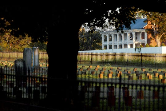 A late afternoon sun illuminates rows of grave markers at the Confederate cemetery at the Historic Carnton Plantation in Franklin Sept. 27, 2005.