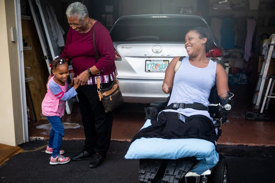 Kayleigh laughs as Aaliyah hugs her grandma Laurel at Kayleigh's parents' home in Coral Springs on Monday, December 10, 2018. Laurel says it is difficult to see her daughter struggle with everyday tasks, but she is glad that Kayleigh is still around and has faith that she will continue getting better.
