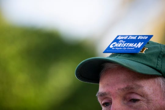 Dan Sheridan wears a Ray Christman pin on his hat during a special election for a vacant Naples City Council position at precinct 462 at St. John Episcopal Church in Naples on Tuesday, April 2, 2019.