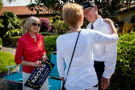 Moss volunteer Jane Cheffy, left, and Naples City Council candidate Bill Moss, right, talk to Ruth Goetz, center, during a special election for a vacant Naples City Council position at precinct 462 at St. John Episcopal Church in Naples on Tuesday, April 2, 2019.