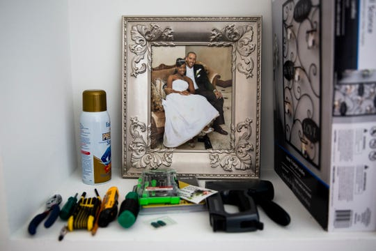A photo of Kayleigh and Ramon on their wedding day sits in an alcove surrounded by home improvement tools at their home in Ave Maria on Saturday, January 12, 2019. Kayleigh and Ramon closed on their house in Ave Maria shortly after Kayleigh's illness, and they try to go there with Aaliyah on the weekends.