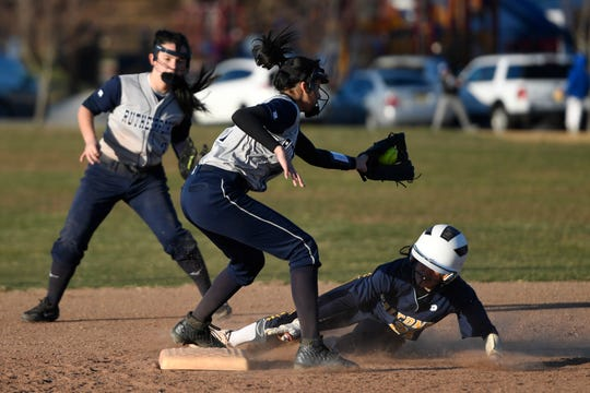 Saddle Brook's Ashley Georgevich slides safely into second base before Rutherford's Veronica Amatucci can place the tag on Monday, April 1, 2019, in Rutherford. Rutherford defeated Saddle Brook in an 11-10 walk-off win for the first game of the season.