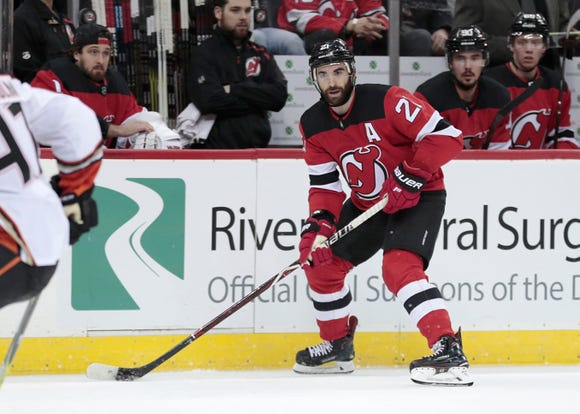 Jan 19, 2019; Newark, NJ, USA; New Jersey Devils right wing Kyle Palmieri (21) plays the puck against the Anaheim Ducks during the second period at Prudential Center.