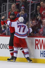 April 1, 2019; Newark, NJ, USA; New Jersey Devils right wing Nathan Bastian (42) and New York Rangers defenseman Tony DeAngelo (77) fight during the second period at Prudential Center. Mandatory Credit: Ed Mulholland-USA TODAY Sports