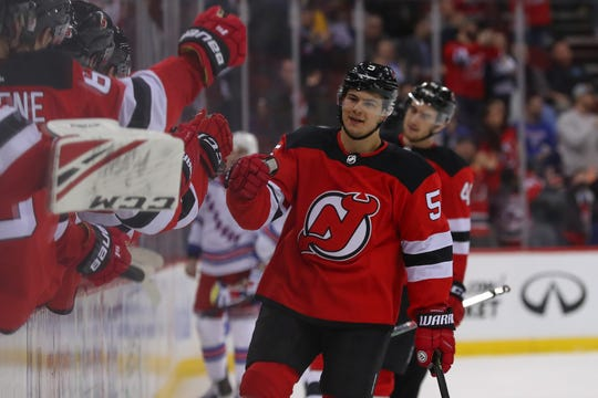 April 1, 2019; Newark, NJ, USA; New Jersey Devils defenseman Connor Carrick (5) celebrates his goal during the third period of their game against the New York Rangers at Prudential Center. Mandatory Credit: Ed Mulholland-USA TODAY Sports