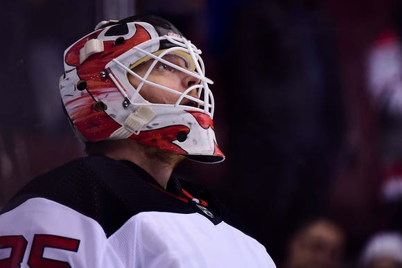 Mar 15, 2019; Vancouver, British Columbia, CAN; New Jersey Devils goaltender Cory Schneider (35) awaits the start of play against the Vancouver Canucks during the first period at Rogers Arena.