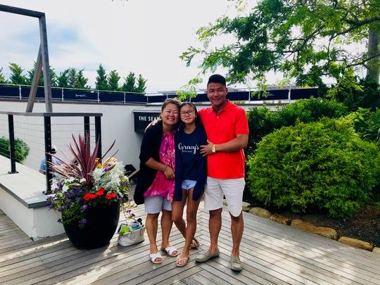 Nancy Fujita, owner of Mt. Fuji Japanese Steakhouse, with daughter Olivia and husband Yoshimasa Tada.