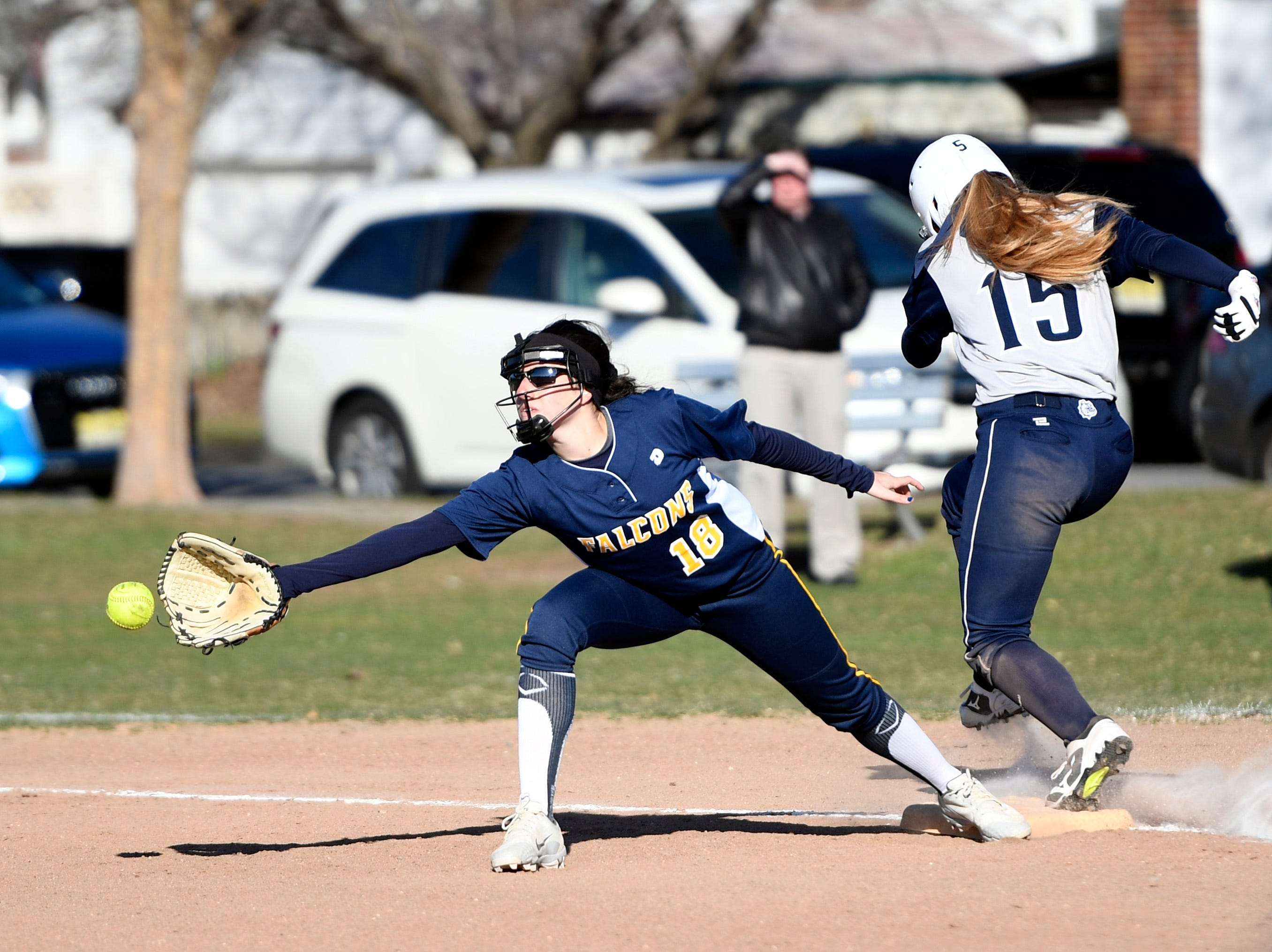 Rutherford's Jordan Finelli (15) is safe at first as Saddle Brook's Jill Berardo reaches for the ball on Monday, April 1, 2019, in Rutherford. Rutherford defeated Saddle Brook in an 11-10 walk-off win for the first game of the season.