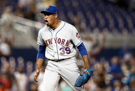 New York Mets relief pitcher Edwin Diaz (39) reacts to a win over the Miami Marlins in a baseball game on Monday, April 1, 2019, in Miami. (AP Photo/Brynn Anderson)