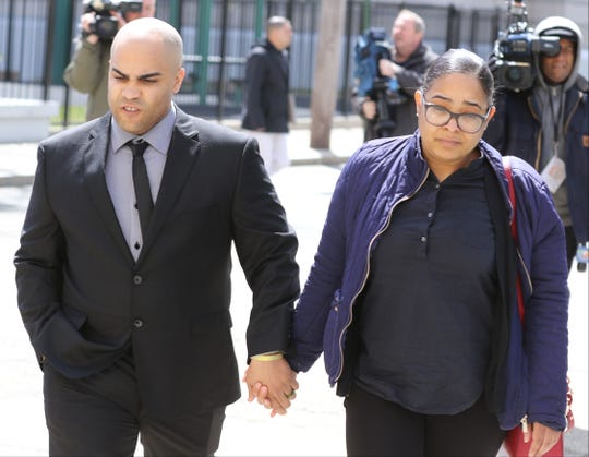 Paterson Police Officer Roger Then leaves the Federal Courthouse with his wife after he was sentenced to six months imprisonment after he pled guilty to participating in an assault on a hospital patient last year.