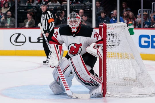 Mar 17, 2019; Denver, CO, USA; New Jersey Devils goaltender Cory Schneider (35) in the second period against the Colorado Avalanche at the Pepsi Center.