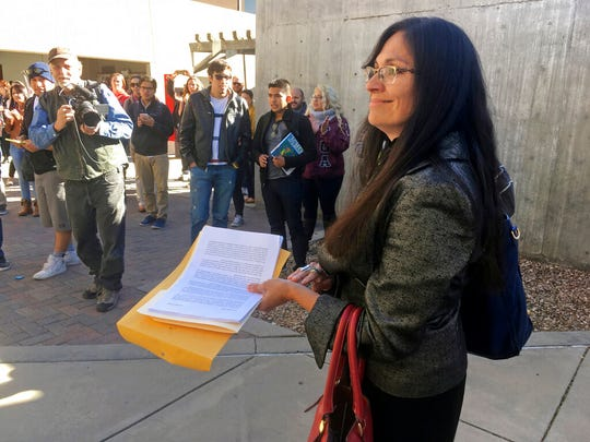 """In this Nov. 18, 2016 file photo, University of New Mexico Chicana and Chicano studies professor Irene Vasquez holds a letter with hundreds of signatures, asking school president Bob Frank to declare the campus a """"sanctuary university,"""" in Albuquerque, N.M. Vasquez and other Mexican American scholars from universities across the country are gathering in Albuquerque on Wednesday, April 3, 2019, for an annual four-day national conference amid uncertainty on immigration and ethnic studies battles on college campuses."""