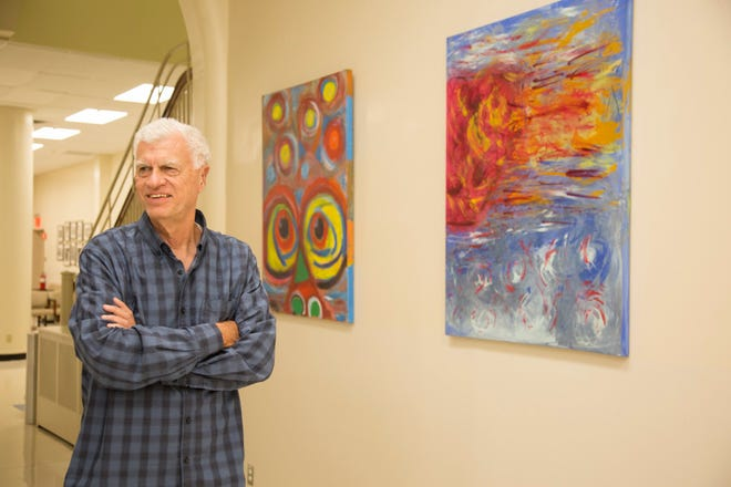 "Artist and NMSU alumnus George Mendoza at the Manhattan Eye, Ear, and Throat Hospital during the installation of his last art collection, ""26 Visions."" His newest collection, ""15 Visions,"" will be erected at the UCLA School of Dentistry."