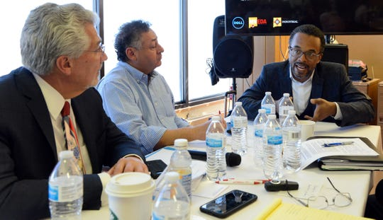 """Dell's Cris Turner, right, speaks to fellow judges Fernando Macias, county manager for Doña Ana County, left, and Jerry Pacheco, president of the Border Industrial Association, during Dell's """"policy hack"""" on Tuesday, April 2, 2019 in Santa Teresa."""