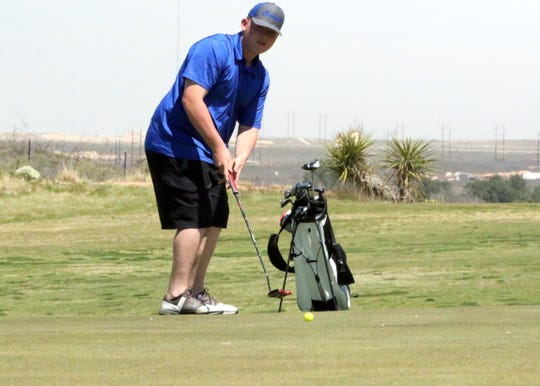 Carlsbad's Mark Parini putts during Tuesday's Eddy County Challenge in Carsbad. He finished the day with a 99.