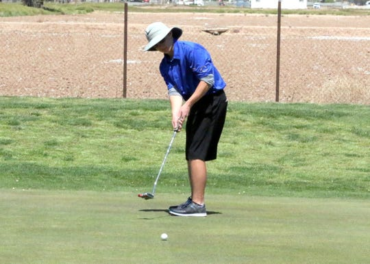 Carlsbad's Eli House putts on the 18th hole during Tuesday's Eddy County Challenge in Carsbad. House came in second place with a two-day total of 159.
