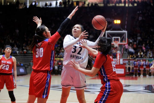 Piedra Vista's Lanae Billy puts up a contested shot against West Mesa's Jazmin Cordova (30) and Esperanza Varoz (15) during the 5A state semifinals on Thursday, March 14 at Dreamstyle Arena in Albuquerque. Billy made the 5A All-State first team.