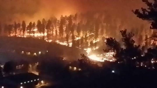 The Moon Mountain Fire threatened homes and a school but was contained with a quick and concentrated response.