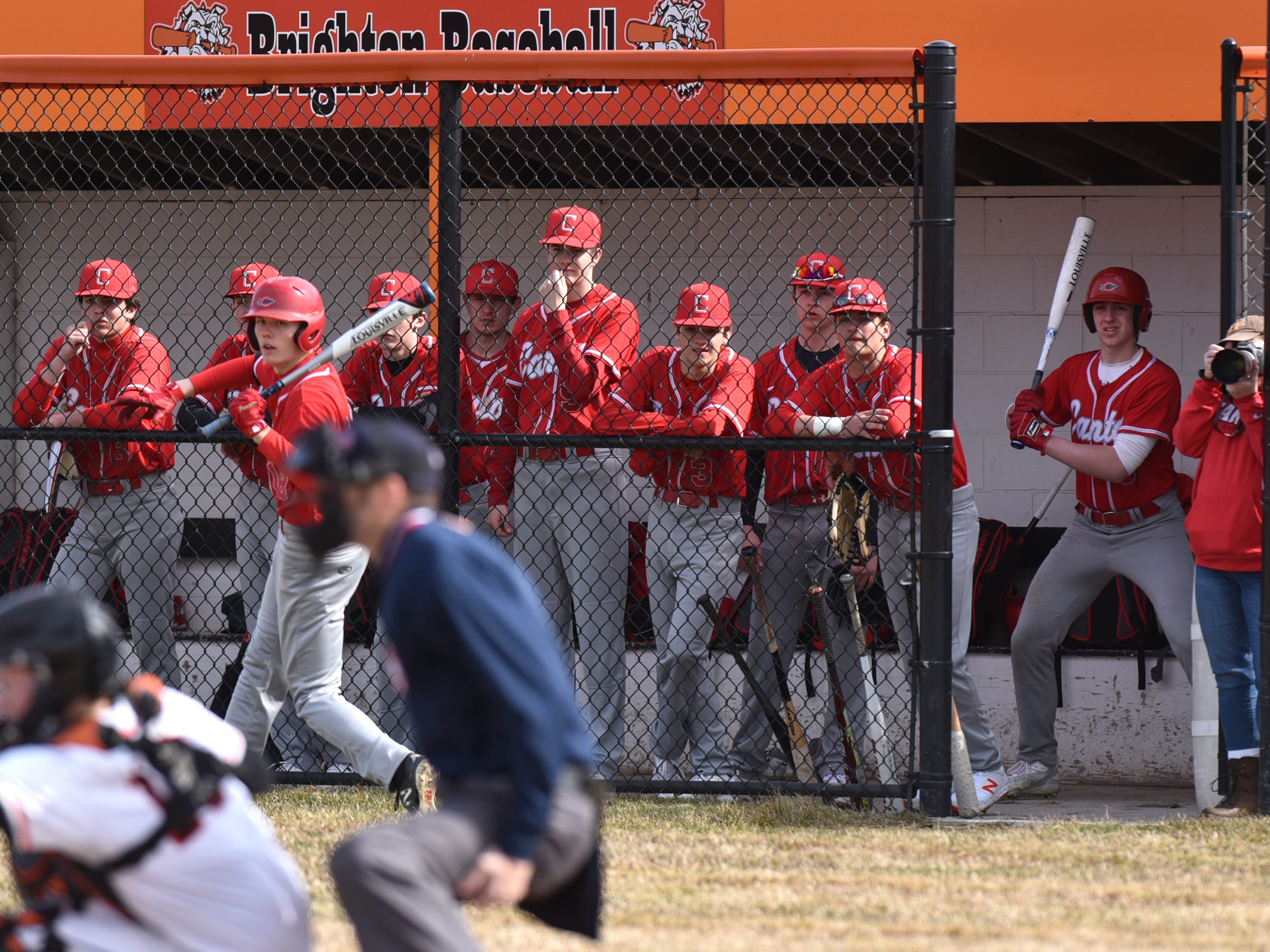 Canton Chiefs watch the action on April 2 from their dugout in Brighton.