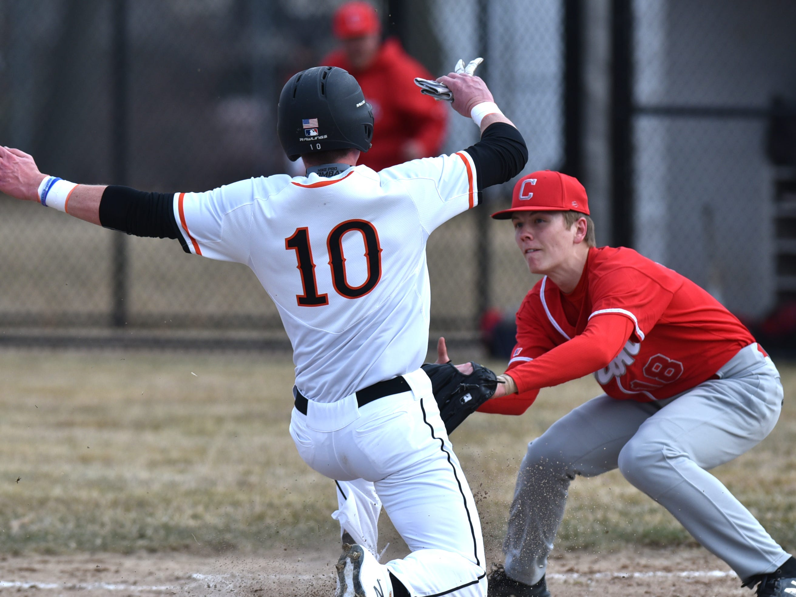 Brighton's Alex DePue is tagged out by Canton's Jake Rubis at home on Tuesday, April 2, 2019.