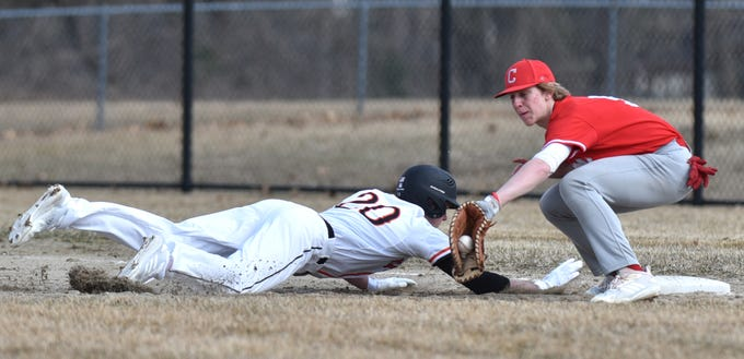 Brighton Bulldog Hunter Weber slides back into first ahead of a tag by Canton's Bryce Mandelka.