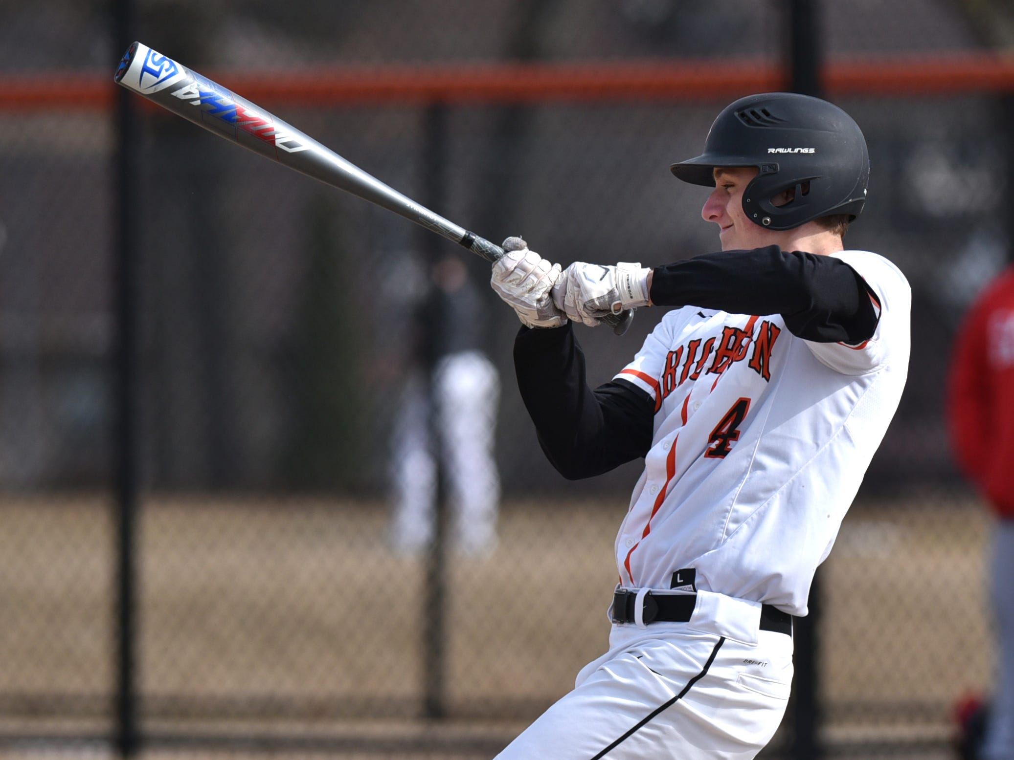 Brighton's Mitchell Marvin swings at a pitch against Canton on Tuesday, April 2, 2019.