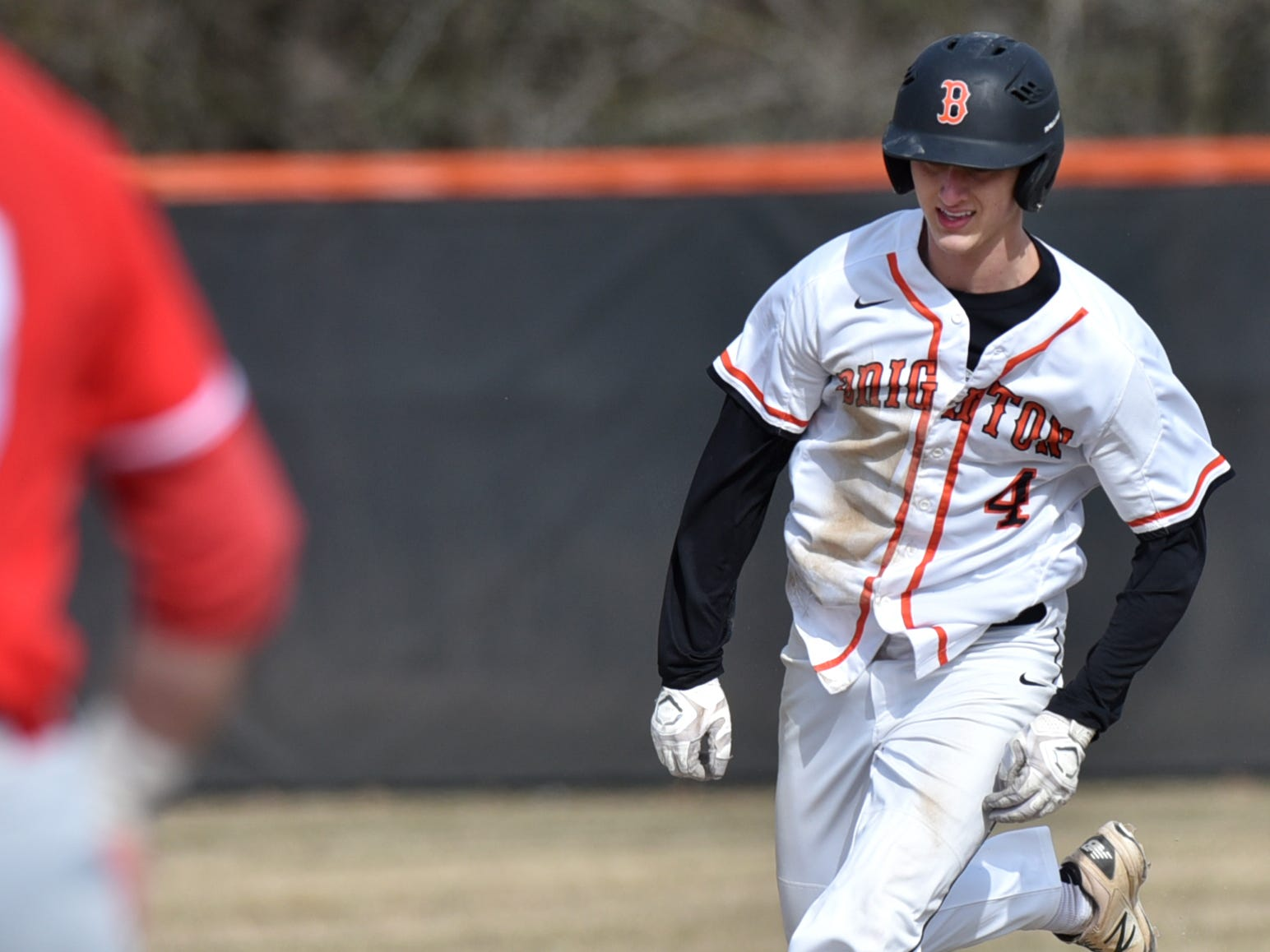 Brighton's Mitchell Marvin heads to third base against Canton on Tuesday, April 2, 2019.