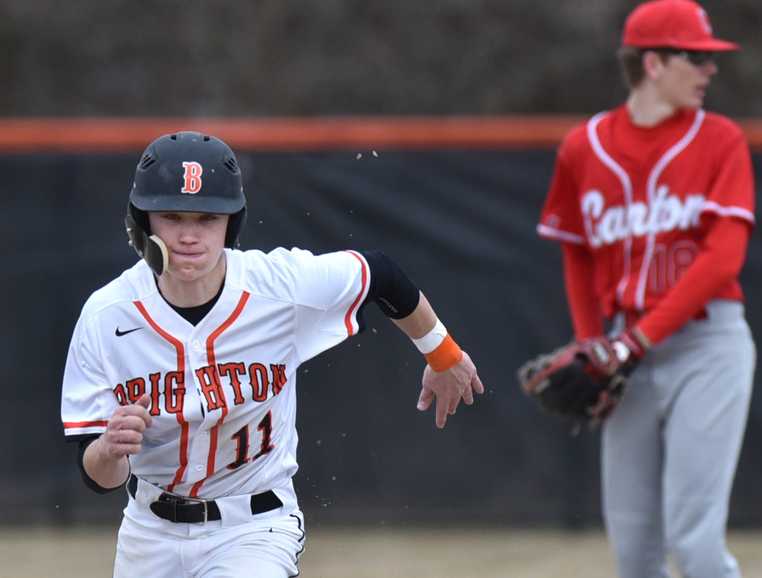 Brighton's Brendan Harrity heads for third base against Canton on Tuesday, April 2, 2019.