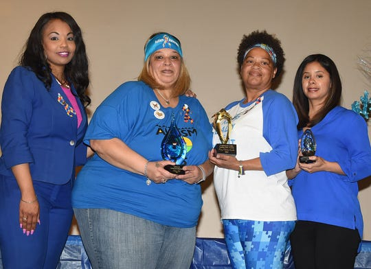 "Ledricka Thierry, Melissa Hall, Mary ""Mel"" Kimble and Davonia Alsandor were recognized on Tuesday for their local contributions to autism awareness during a presentation at the Opelousas Civic Center."