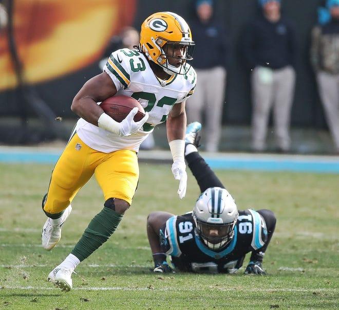Packers running back Aaron  Jones carries against Carolina last season.