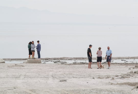 Visitors check out the Salton Sea at the small town of Salton Sea Beach, March 27, 2019.
