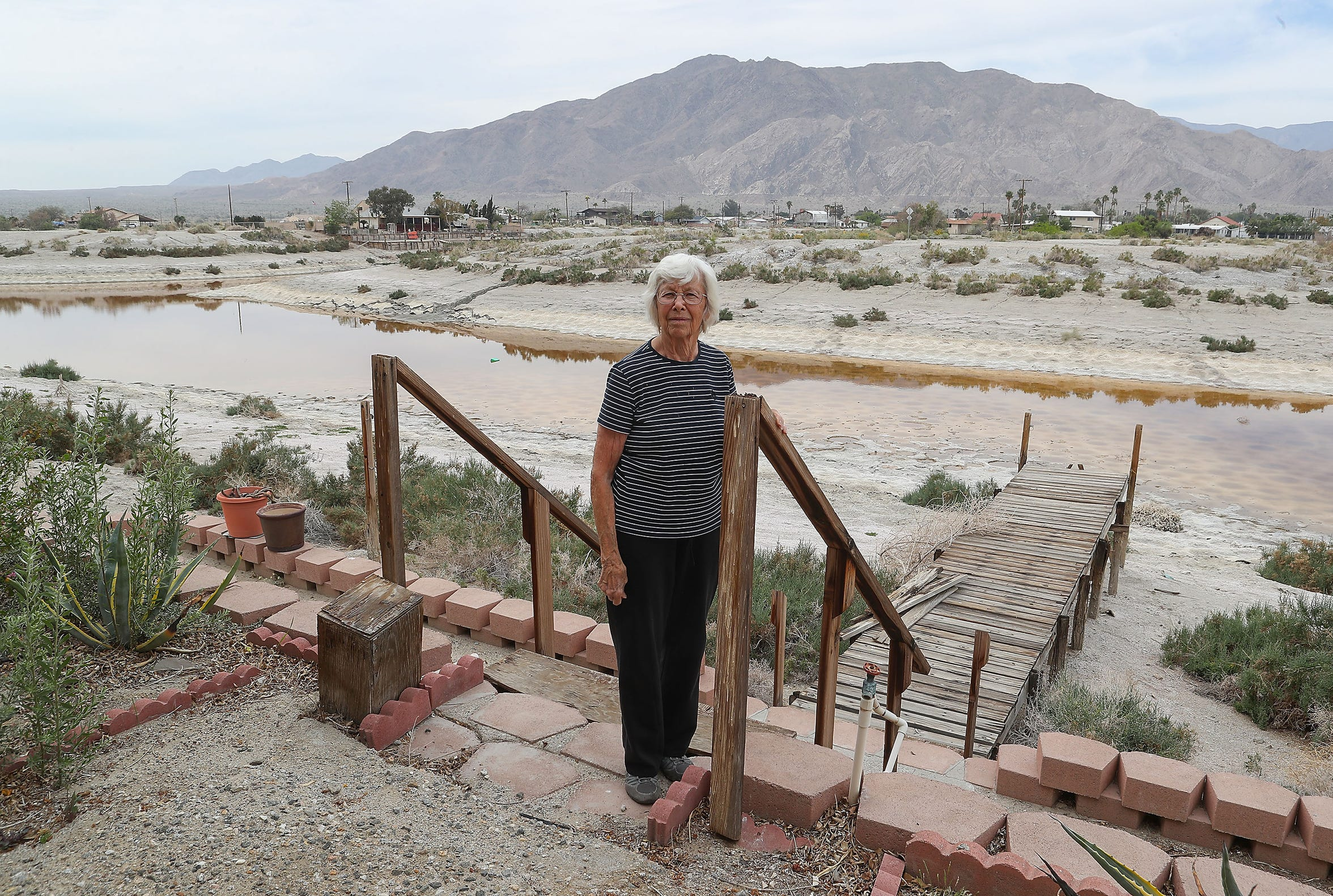 Nellie McConnell and her late husband built a house on the Salton Sea decades ago to enjoy their boat. As the lake has dried up, the water  no longer reaches her dock, and she often experiences nasal respiratory irritation. March 27, 2019. Jay Calderon/The Desert Sun