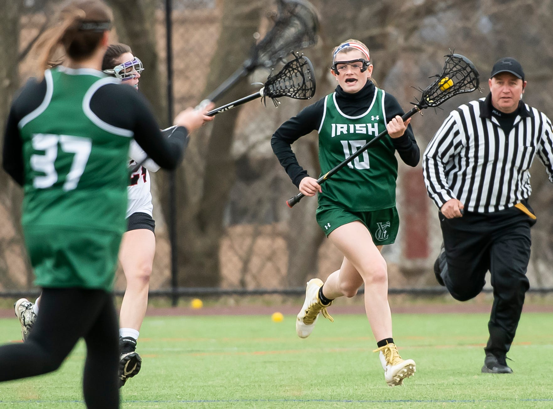 York Catholic's Sydney Mentzer (10) runs down the field during a YAIAA lacrosse game against South Western in Hanover on Tuesday, April 2, 2019. Mentzer lead all scorers with five goals on five shots and had two assists as York Catholic won 19-7 and improved to 5-0.
