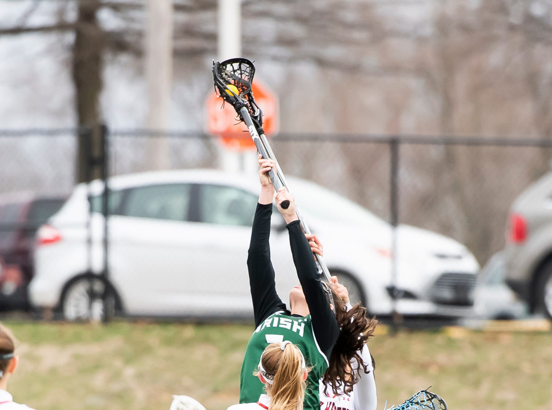 York Catholic wins a face-off during a YAIAA lacrosse game against South Western in Hanover on Tuesday, April 2, 2019. York Catholic won 19-7 and improved to 5-0.