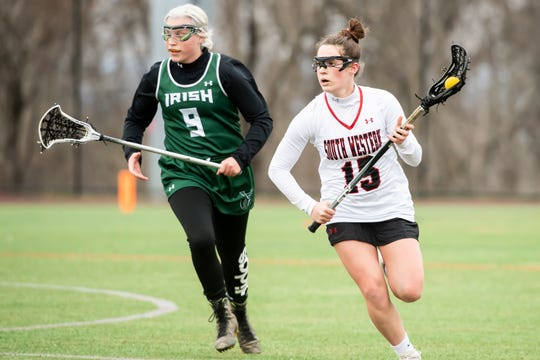 South Western's Jordan Gertz (15) runs down the field during a YAIAA lacrosse game against York Catholic in Hanover on Tuesday, April 2, 2019. Gertz, a 2019 grad, was named the league Defender of the Year.