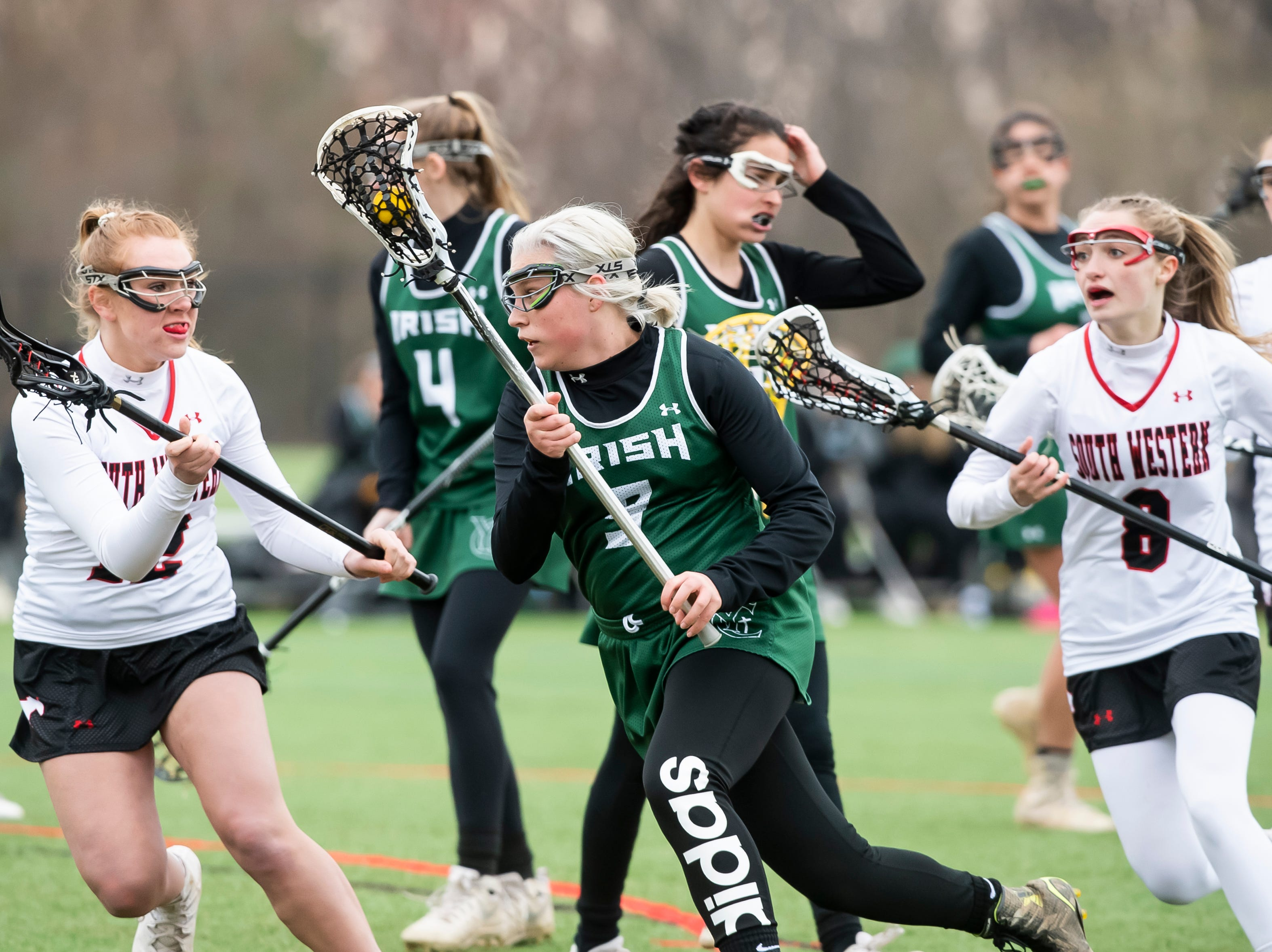 York Catholic's Kennedy Eckert controls the ball during a YAIAA lacrosse game against South Western in Hanover on Tuesday, April 2, 2019. York Catholic won 19-7 and improved to 5-0.