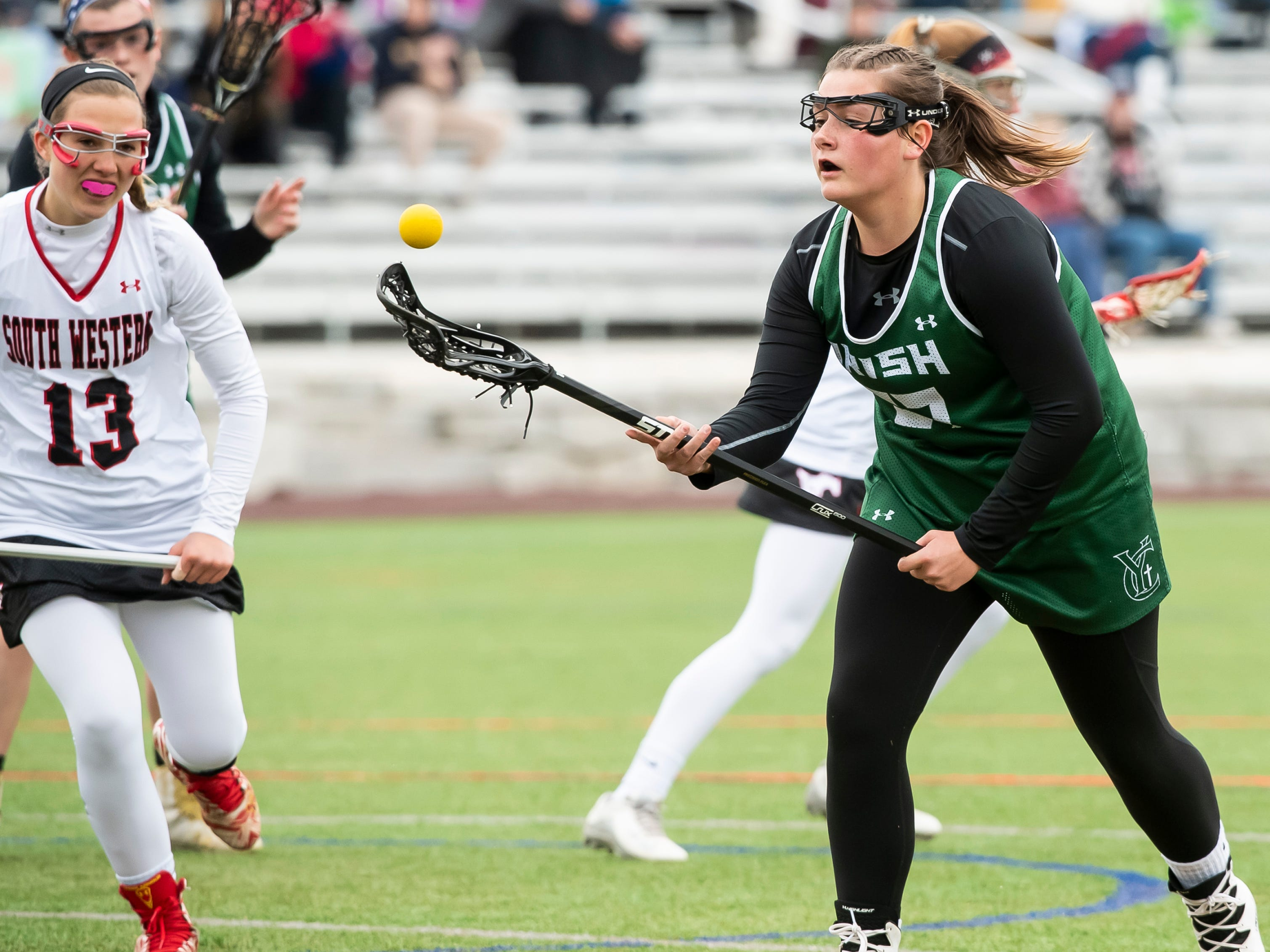 York Catholic's Ella Linthicum regains control of the ball during a YAIAA lacrosse game against South Western in Hanover on Tuesday, April 2, 2019. Linthicum finished with three goals and one assist as York Catholic won 19-7 and improved to 5-0.