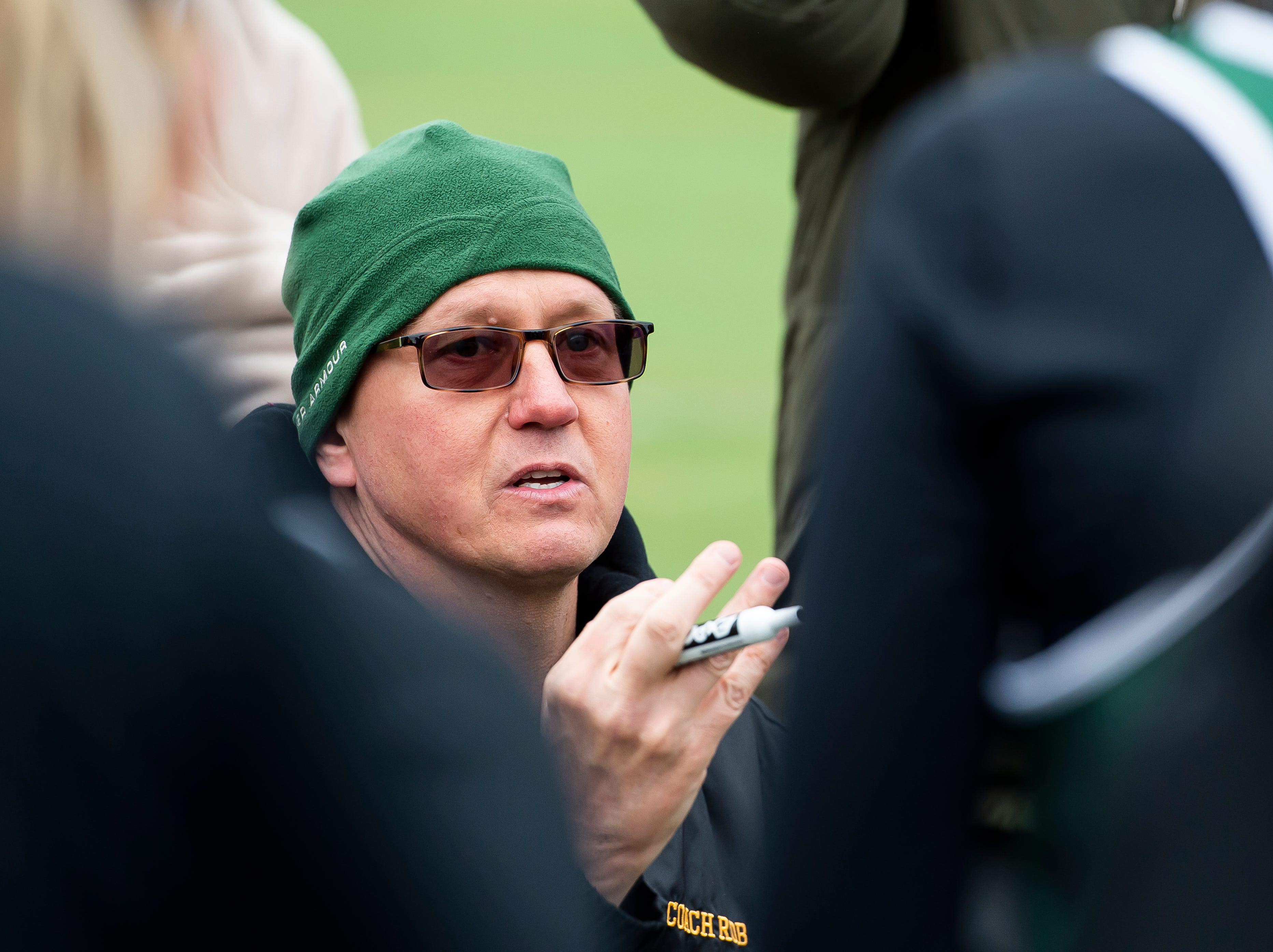York Catholic girls lacrosse head coach Rob Linthicum talks with his team during halftime in a YAIAA lacrosse game against South Western on Tuesday, April 2, 2019. York Catholic won 19-7 and improved to 5-0.