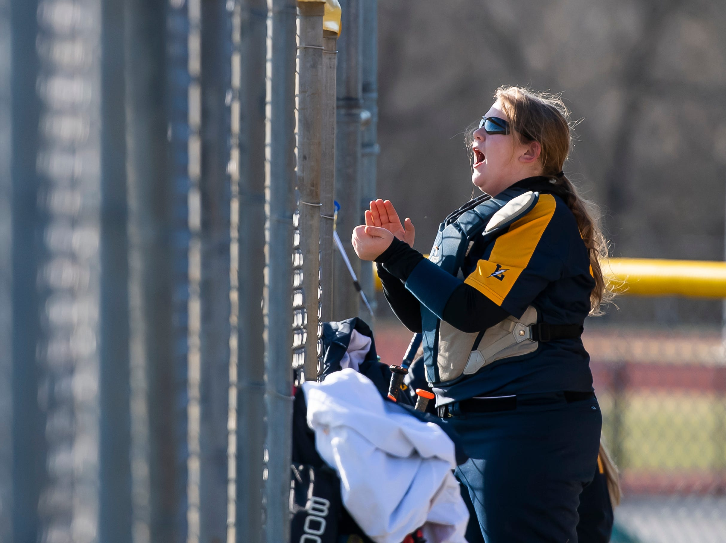 Littlestown's Bailey Smith cheers from the dugout as the Bolts score a run during a YAIAA softball game against Gettysburg on Monday, April 1, 2019. The Bolts won 10-4.