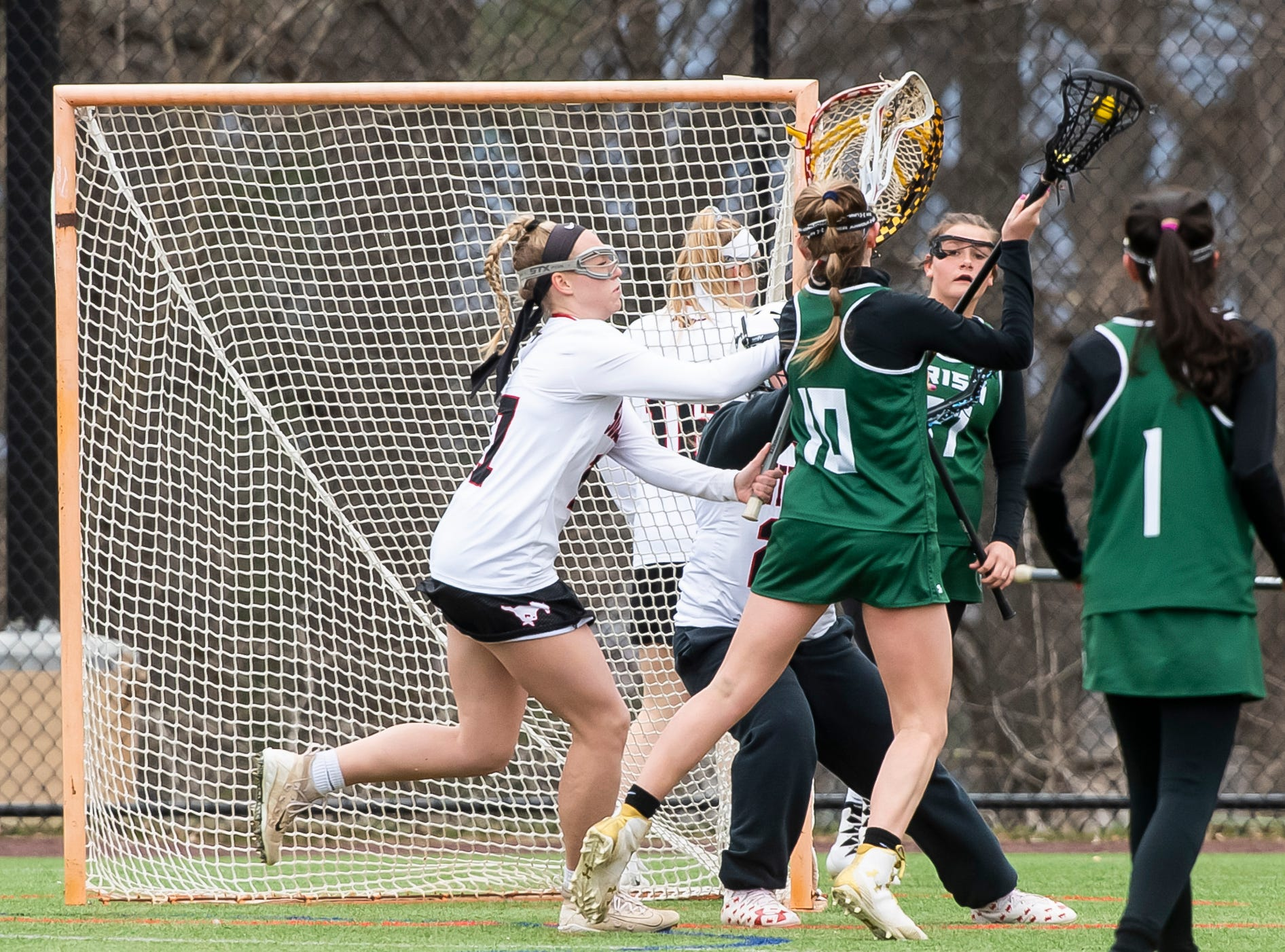 York Catholic's Sydney Mentzer (10) shoots and scores during a YAIAA lacrosse game against South Western on Tuesday, April 2, 2019. York Catholic won 19-7 and improved to 5-0.