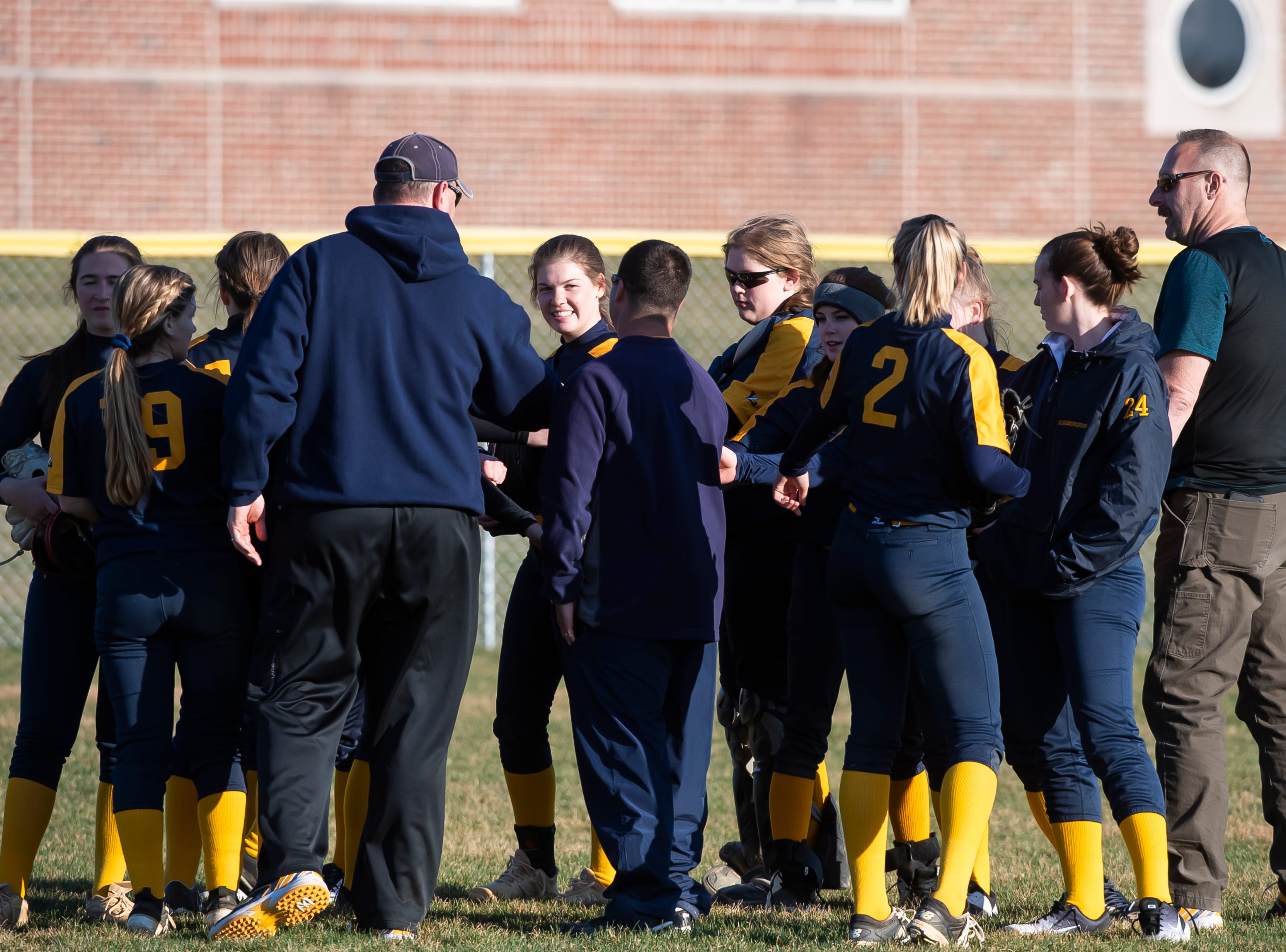 The Littlestown Bolts meet in the outfield after defeating Gettysburg 10-4 in a YAIAA softball game on Monday, April 1, 2019.