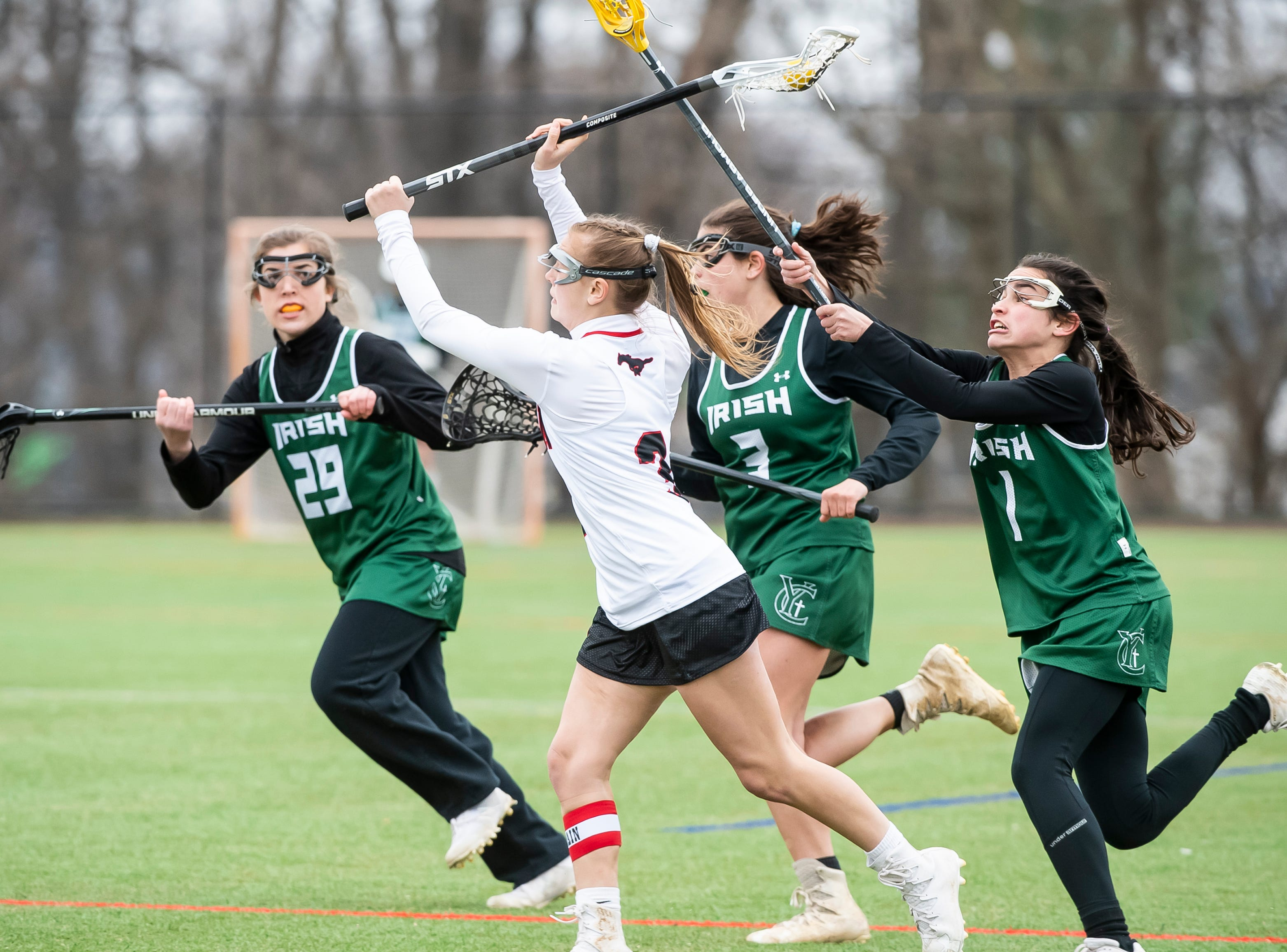 South Western's Sophie Mace gets a pass off while being pressured by York Catholic's Olivia Staples (1) and Shannon Staples (3) during a YAIAA lacrosse game in Hanover on Tuesday, April 2, 2019. South Western fell 19-7.